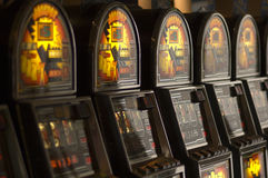 Slot machines. A row of slot machines or one armed bandits Stock Images