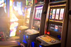 Slot machines in a casino. Gambling and arcade games concept Stock Photo