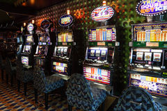Slot machines in play room at liner Costa Luminosa Stock Photo