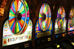 Slot machines. Wheel of fortune slot machines in a Las Vegas casino Stock Photo