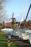 Sloten with windmill and sailboat. Netherlands. Stock Photos