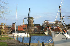 Sloten with windmill and sailboat. Netherlands. Stock Photo