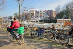 Sloterdijkerbrug bridge with bicycles and houseboats in the foreground, Prinseneiland, Amsterdam royalty free stock photo
