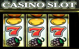 Slots. Casino slots three sevens close up royalty free stock images