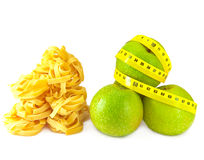 Slots paste and apple with a measuring tape. Royalty Free Stock Image