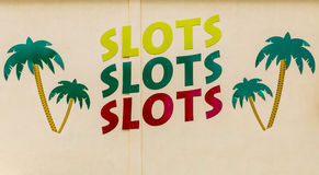 Slots Sign with Palm Trees Royalty Free Stock Images