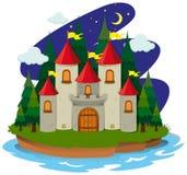 Slott på ön på natten Royaltyfri Bild