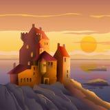 Slott på kusten på solnedgången Royaltyfria Bilder