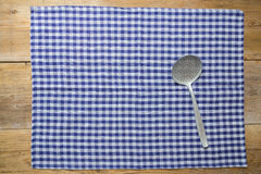 Slotted spoon and kitchen towel on rustic wooden background Royalty Free Stock Photography