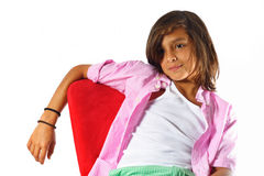 Slouching on a Chair. Boy Slouching on a Chair with his arm slung over the back Stock Images