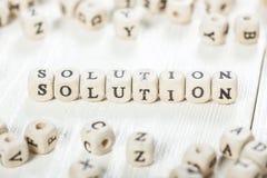 Sloutions-Wort geschrieben auf hölzernen Block Stockfoto