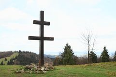 Slovak cross on Javornik mountain. Wooden Slovak cross on mountain Javornik on Javorniky mountains in Morava on border of Czech Republic and Slovakia stock photo