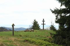 Slovak cross on Javornik mountain. Wooden Slovak cross, sign of national park and benches around fire place on mountain Javornik on Javorniky mountains in Morava stock photography