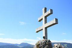 Slovak cross on Rockery Liptovsky Hradok. With hills and blue sky behind in village Liptovsky Hradok in Slovakia stock photos