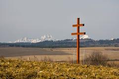 Slovak double cross and Vysoke Tatry. Slovak double cross near Levoca town and Vysoke Tatry mountains on horizon during spring, Europe, Slovakia royalty free stock photography