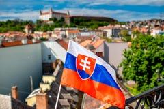 Slovak flag on Bratislava city background. Slovak flag on the old town background and Bratislava castle in Slovakia stock photos