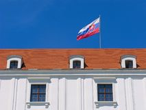 Slovak flag. On roof of Bratislava castle. Sunny day, clear blue sky stock image