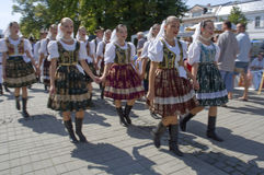 Slovak folklore. Slovak women in folklore costumes walking down the street and singing, photo taken in Humenne, Slovakia Stock Images