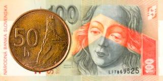 50 slovak halier coin against 100 slovak koruna banknote obverse. Specimen stock photos