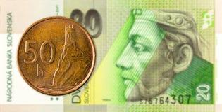 50 slovak halier coin against 20 slovak koruna banknote obverse. Specimen royalty free stock images