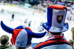 Slovak hockey fans. Slovak ice hockey fans watching the match royalty free stock photo