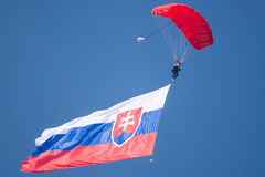 Slovak International Air Fest 2015, Sliac, Slovakia. SLIAC, SLOVAKIA - AUGUST 30: parachutist with giant Slovak flag in the air at SIAF airshow in Sliac royalty free stock photo
