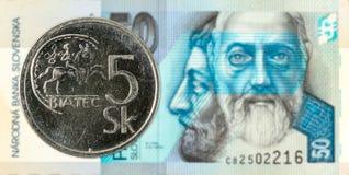 5 slovak koruna coin against 50 slovak koruna banknote obverse. Specimen royalty free stock photography