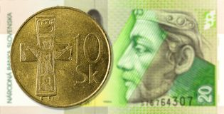 20 slovak koruna coin against 20 slovak koruna bank note obverse. 10 slovak koruna coin against 20 slovak koruna bank note obverse, specimen royalty free stock images