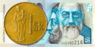 1 slovak koruna coin against 50 slovak koruna bank note obverse. Specimen royalty free stock images