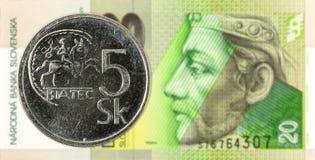 5 slovak koruna coin against 20 slovak koruna banknote obverse. Specimen royalty free stock image