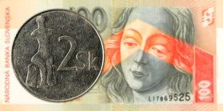2 slovak koruna coin against 100 slovak koruna banknote obverse. Specimen stock photos