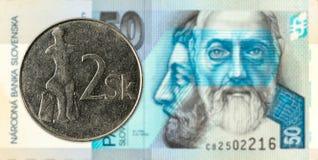 2 slovak koruna coin against 50 slovak koruna banknote obverse. Specimen stock image