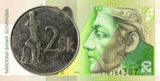 2 slovak koruna coin against 20 slovak koruna banknote obverse. Specimen stock photography