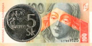 5 slovak koruna coin against 100 slovak koruna banknote obverse. Specimen stock photography