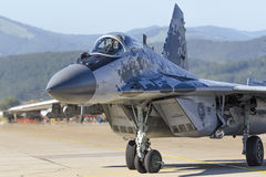 Slovak MiG 29 Fulcrum. Pilot in cockpit of Slovak MiG 29 Fulcrum on runway at SIAF airshow Stock Photos