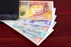 Slovak money in the black wallet. On a wooden background royalty free stock photo