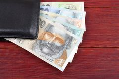 Slovak money in the black wallet. On a wooden background royalty free stock photography