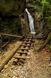 Slovak Paradise National Park. Picturesque view of a waterfall and wooden ladders in Slovak Paradise National Park royalty free stock images