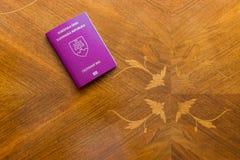 Slovak passport on a wooden table. Slovak passport on brown wooden table stock photo