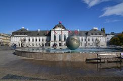 Slovak presidential palace. Building on sunny day with fountain in front. Hodzovo namestie, Bratislava, Slovakia. Buildings official name is Grassalkovich Royalty Free Stock Image