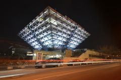 Slovak Radio Building at night. The Slovak Radio Building is located in Bratislava. It is shaped like an upside down pyramid. Architects of this project were stock photography