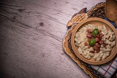 Slovak traditional dishes potato gnocchi with sheep`s cheese, on a wooden table laid on the table. Slovak traditional meals, potato gnocchi with sheep`s cheese stock photography
