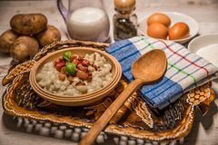 Slovak traditional dishes potato gnocchi with sheep`s cheese, on a wooden table laid on the table. Slovak traditional meals, potato gnocchi with sheep`s cheese stock images