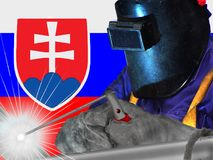 SLOVAK WELDER WITH BACKGROUND OF HIS FLAG WAVES. WORKER THAT GENERATES WELL-BEING AND RICHES TO HIS COUNTRY AND TO THE WHOLE WORLD royalty free stock image