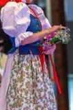 Slovak dancer in traditional costume. Slovak woman dancer in traditional costume. Detail stock images