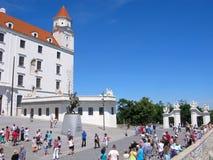 Slovakia, Bratislava castle, tourists, monument to Svatopluk. Bratislava, Slovakia. Large group of people on an observation deck at the Bratislava castle. Before Royalty Free Stock Photo