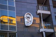 2018 Slovakia, Bratislava. Modern sculpture. Ear sculpture on the wall of the house stock photography