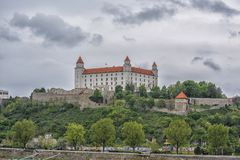 Slovakia, Bratislava - November 5th, 2017 Bratislava Castle on the hill, Parliament and Danube river royalty free stock images