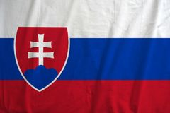 Slovakia flag background with fabric texture. Royalty Free Stock Photo