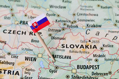 Slovakia flag on map. Slovakia paper flag pin on a map (series image Stock Images